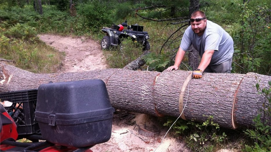 SORVA member working on clearing a large downed tree from the trail